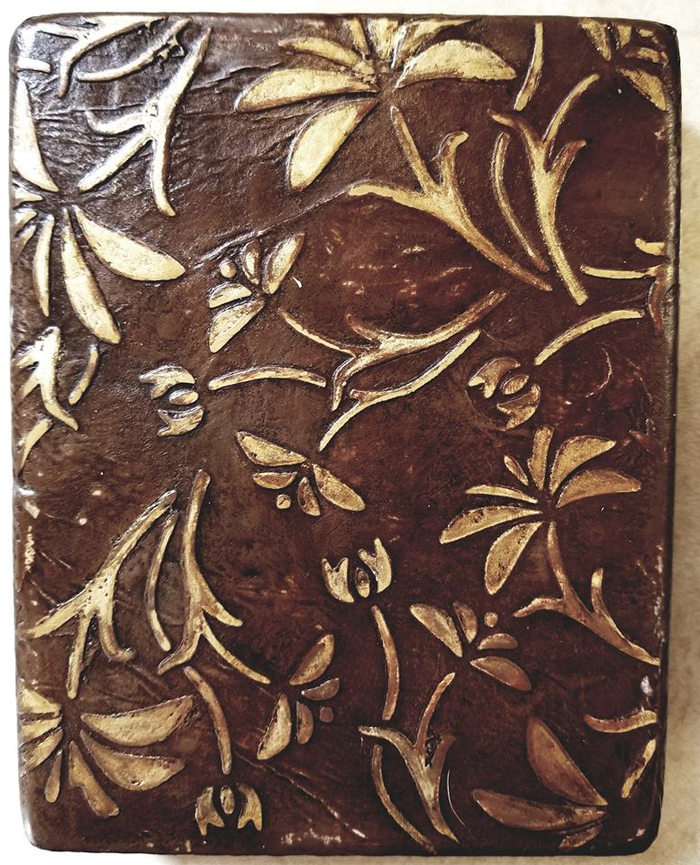 """Old West"" embossed & gilded leather"