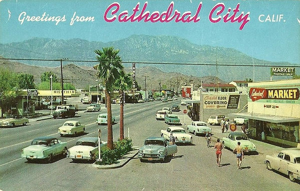 Hwy 111 with visitors and vintage cars - postcard