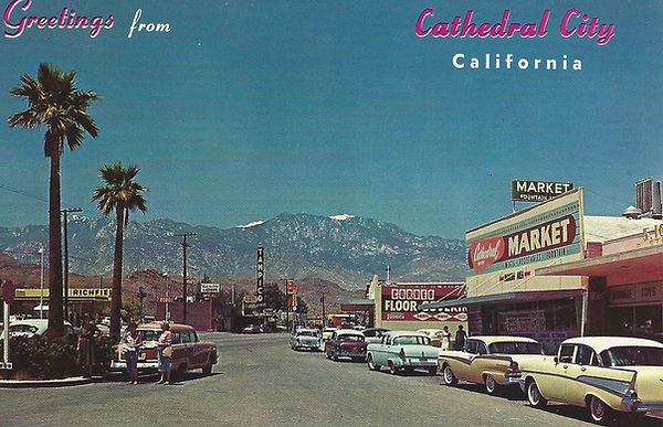 Hwy 111 with market, businesses and vintage cars 1950s postcard