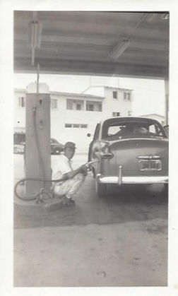 Inside gas station with vintage car and worker