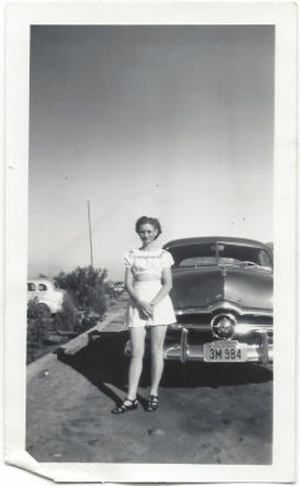 """Zuma """"Tiny"""" Henry in front of vintage car in 1940s Cathedral City, CA"""