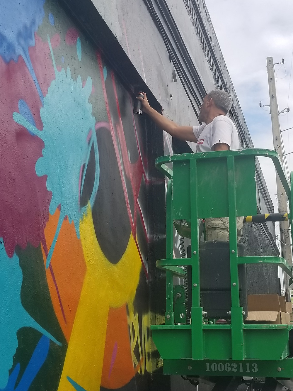 Artist, Crash, working on a mural in Wynwood