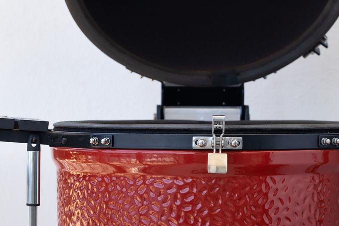 ceramic egg smoker. red bbq close up.whi