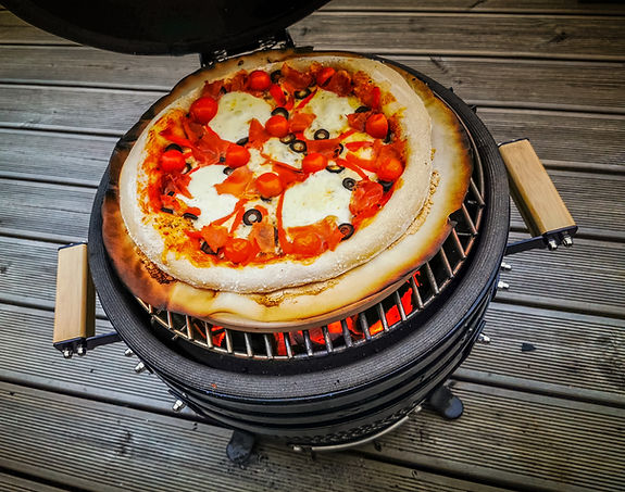 Homemade pizza baked on a kamado cook st