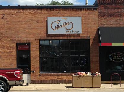 Nicollet Bike Shop - Custom powder coated aluminum sign panel with routed graphics and reverse LED illumination