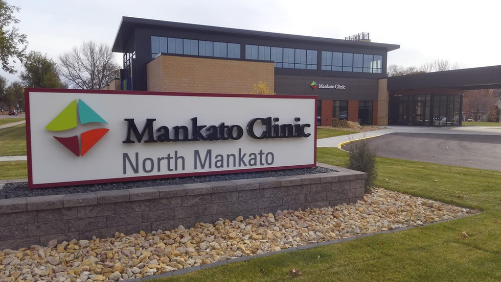 Mankato Clinic - Monument sign and building sign. Reverse illuminated channel letters.