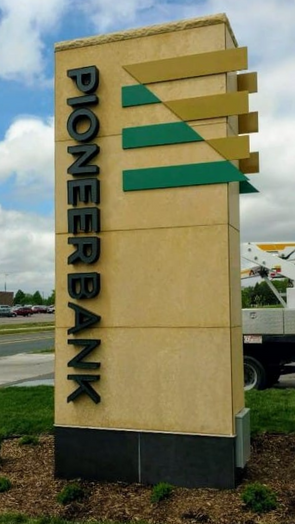 """Pioneer Bank Mankato - Front illuminated channel letters with 1/2"""" painted aluminum logos"""