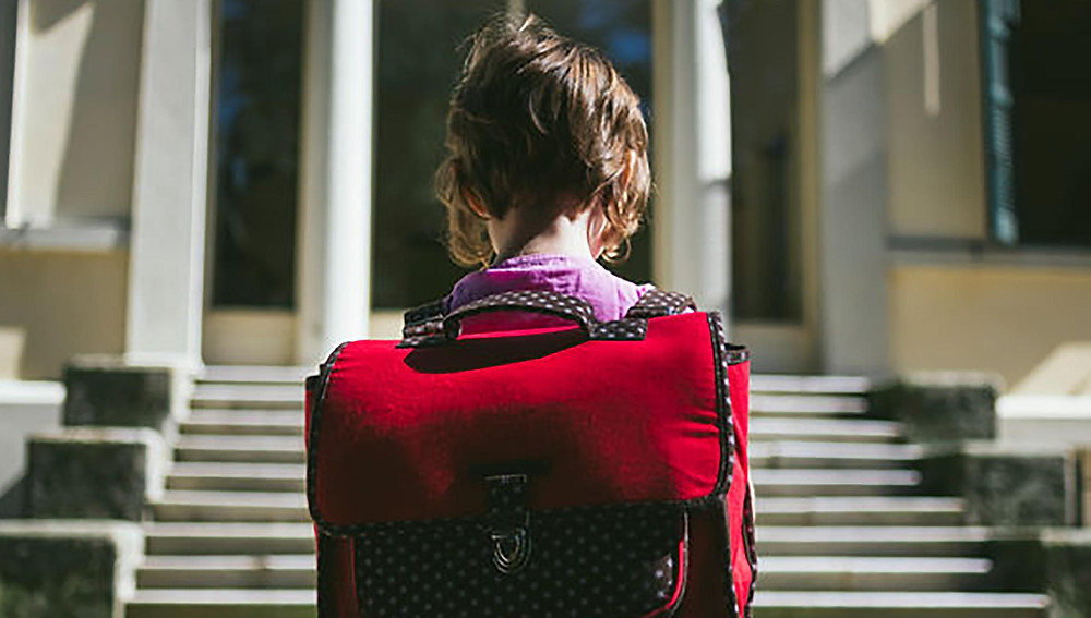 Child with racksack on first day of school