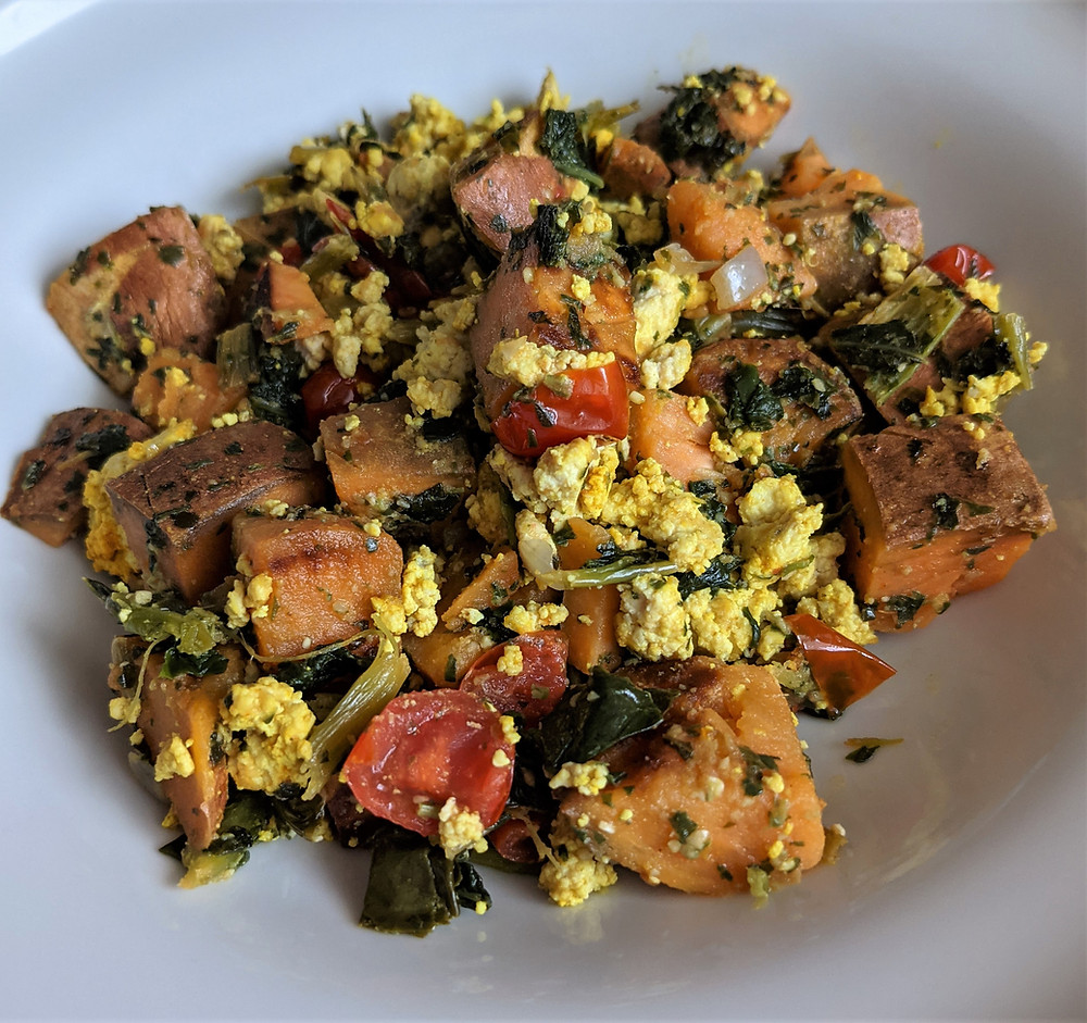 cubed sweet potatoes, kale, tofu scramble, and tomatoes