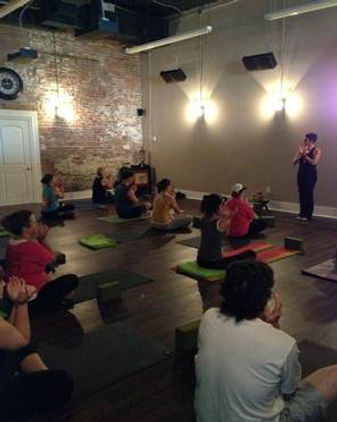 Hot Yoga Studio class with electric infrared heaters installed