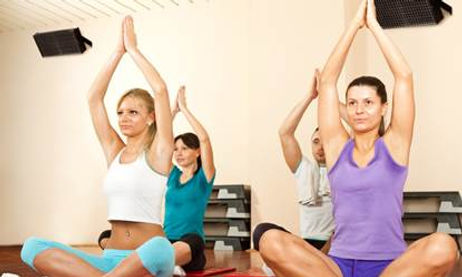 Women using our hot yoga studio heating while working out
