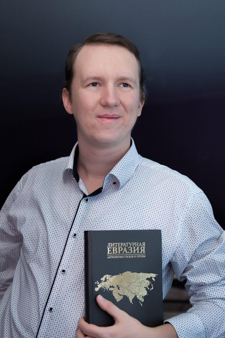 Алексей Комзиков
