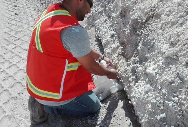 Geologist taking samples