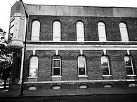 Black and white picture of the Legacy Building at 1 W Front Street El Paso, Illinois