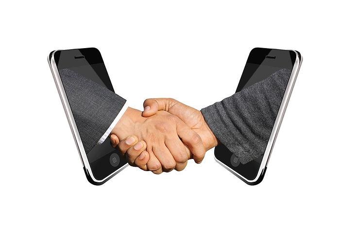 handshake-across-smartphones.jpg