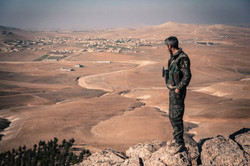 YPG fighter on a mountain