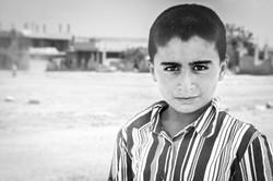 Portrait of a boy in Kobane