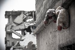 Teddy bears hanging in Kobane