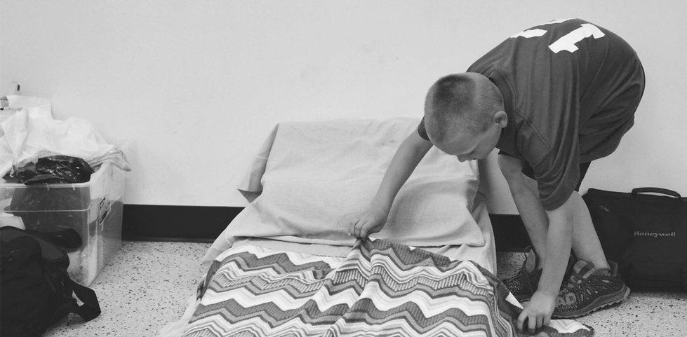 Boy making bed_edited_edited.jpg