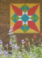 Yellow and red Skyrocket barn quilt with flowers