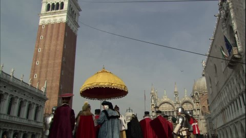 686964192-st-mark's-square-costume-carnival-bell-tower-venice-italy