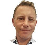 Travis Headshot 2021 - Website.jpg