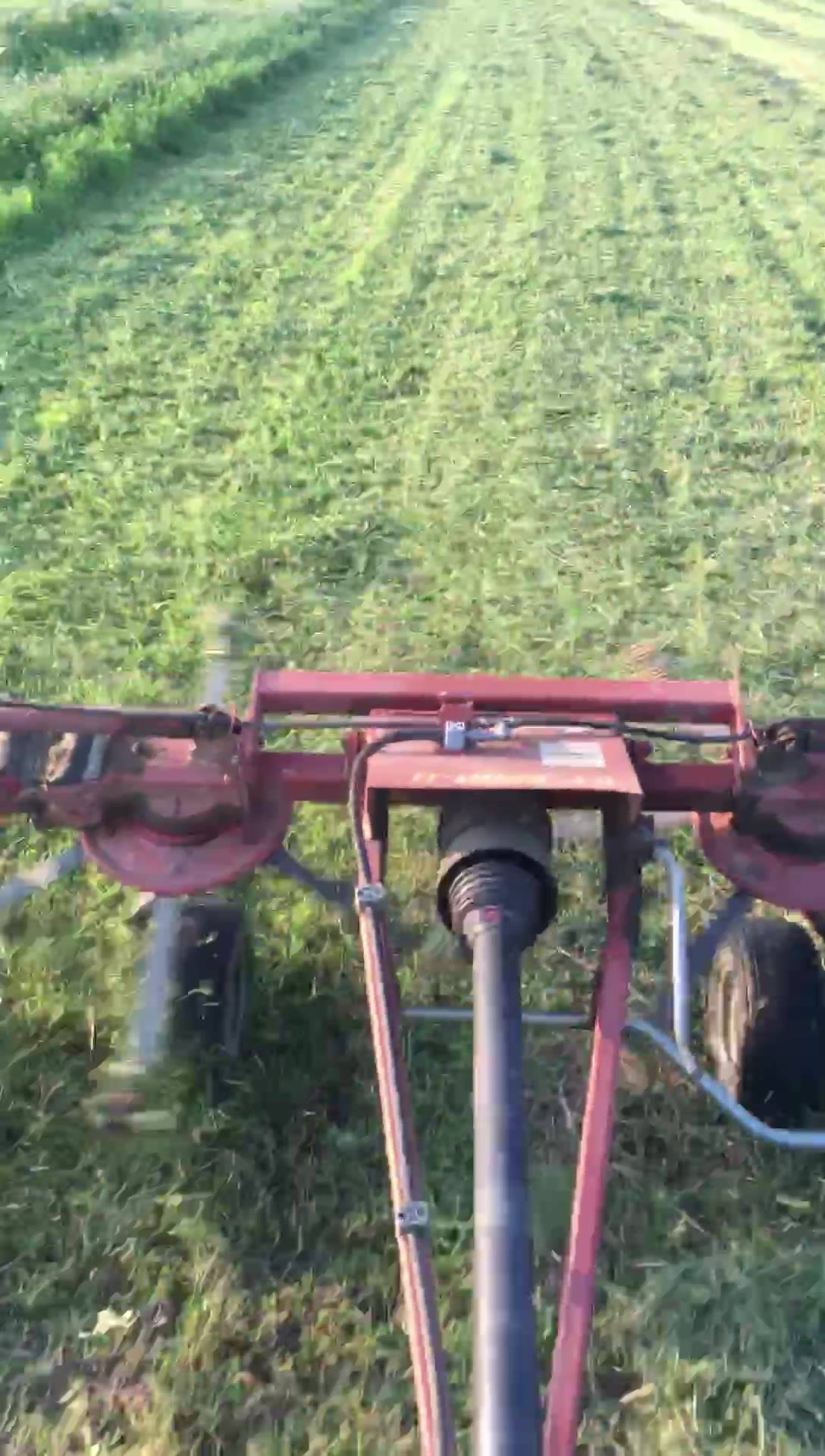 "We ""tedded"" some hay tonight. The ""tedder"" helps the hay dry more evenly and thus be of better quality when bailed up. Here's a video to see how it works!"