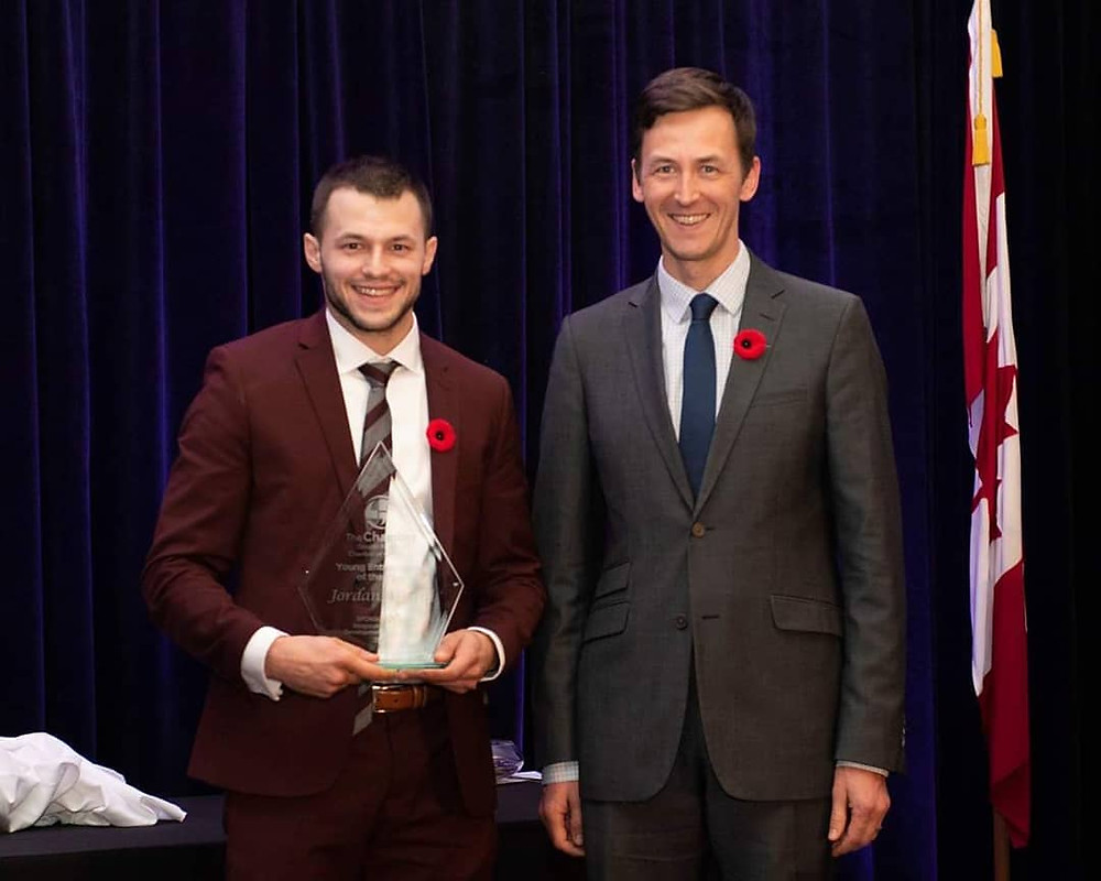 "Jordan Milani accepts the Kingston Chamber of Commerce ""2018 Young Entrepreneur of the Year"" Award"
