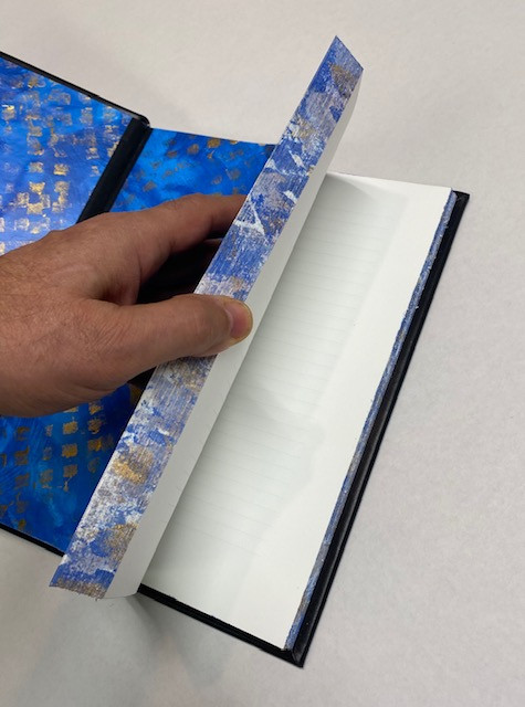 hand torn edges painted to match endpapers
