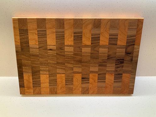 Large hardwood chopping board, walnut, aframosia and cherry.
