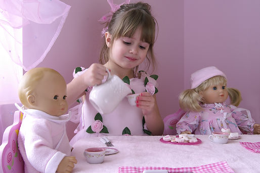A young girl having a tea party with her