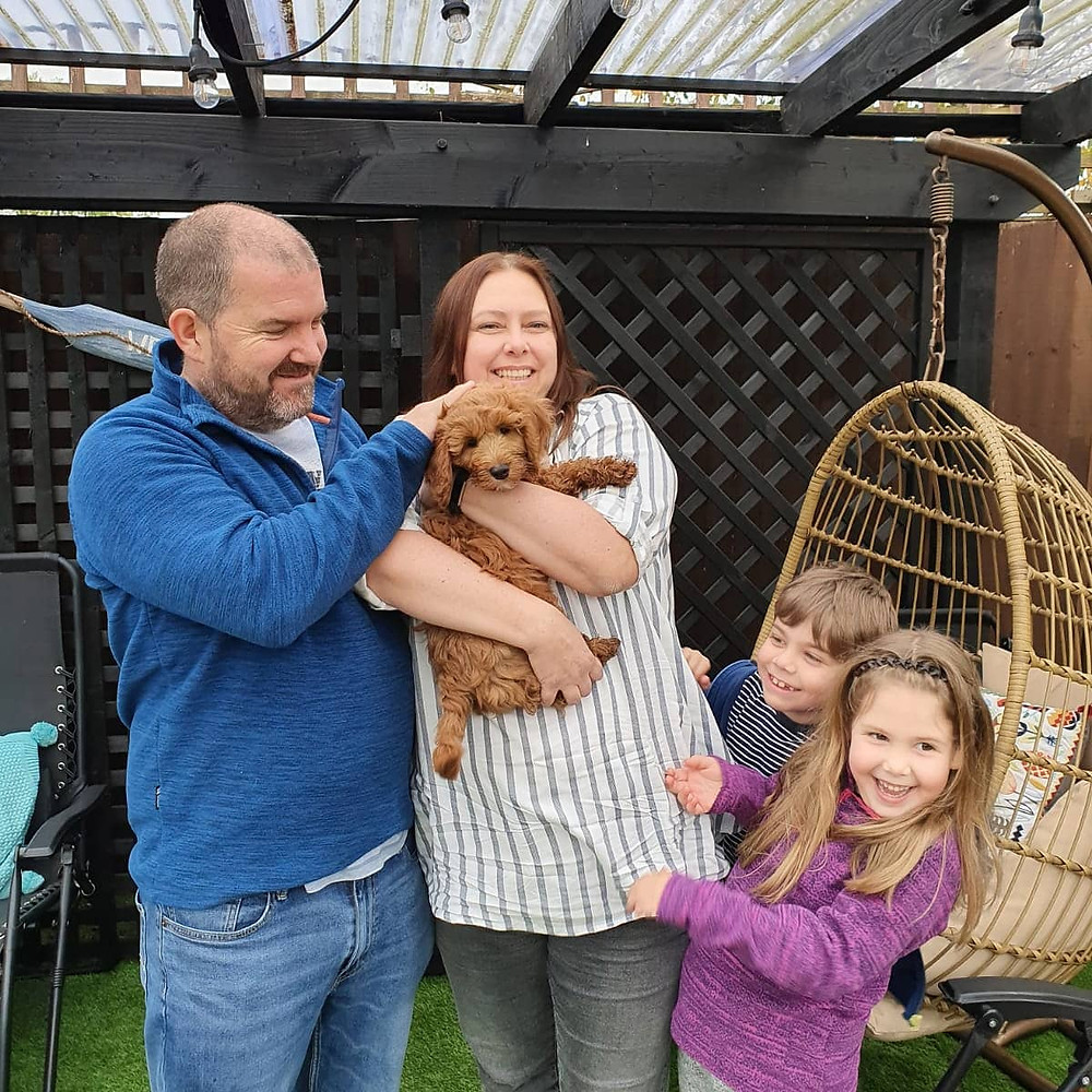 Happy family with their trained puppy