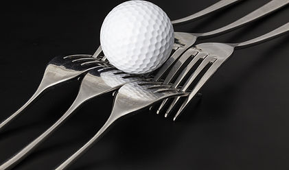 Forks%20and%20golf%20balls%20on%20a%20bl