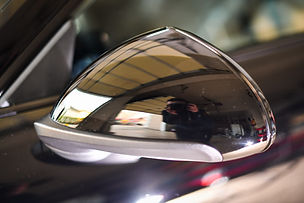 Scratches repaired on sideview mirror by Chicago professional auto detailer