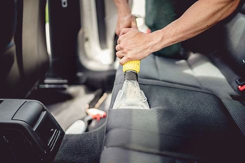 Chicago auto detailer performing dirt extraction on car seats