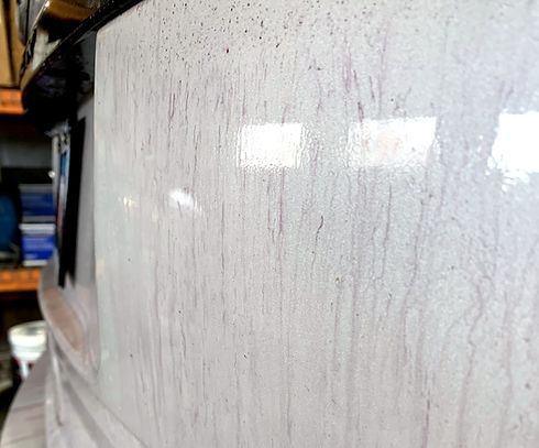 Chemical paint decontamination on white SUV by Aesthetic Detail Studio