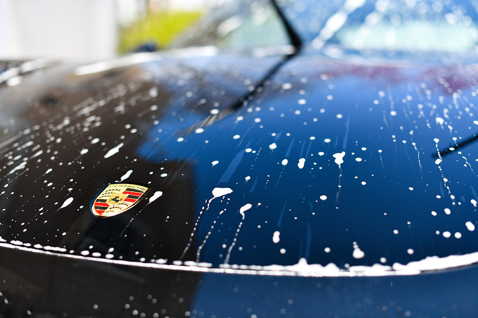Soap on surface of Porsche 911 after professional hand wash