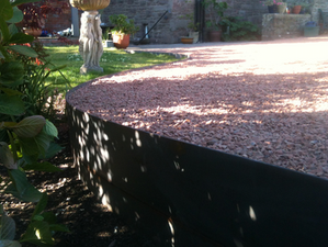 Metal curved edging and floating paving