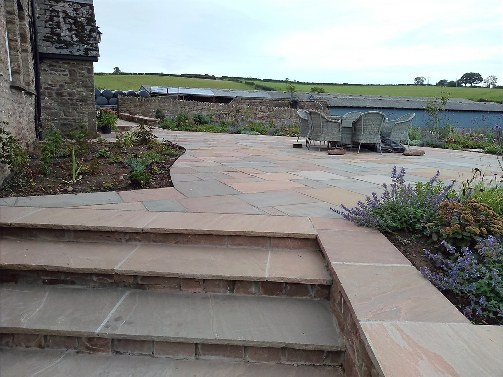 indian sandstone paving, coping stones, natural walling, planting beds
