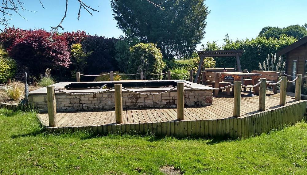 pond liner, coping stones, walling, wildlife pond, decking, posts, rope