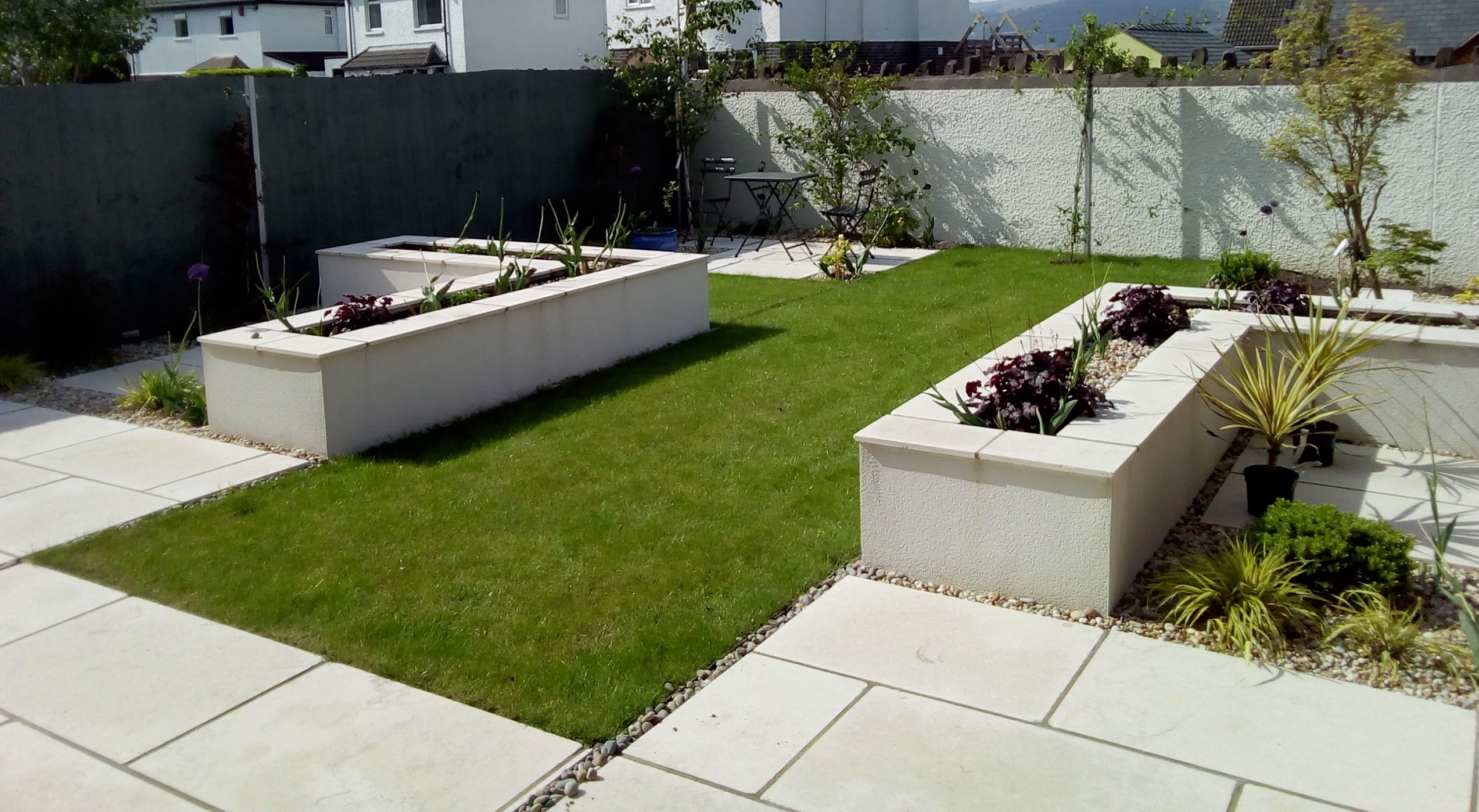 Raised planters and limestone paving