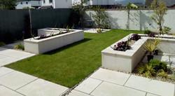 Raised planters and limestone paving