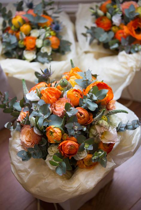 Bridesmaid Bouquets with orange ranunculus