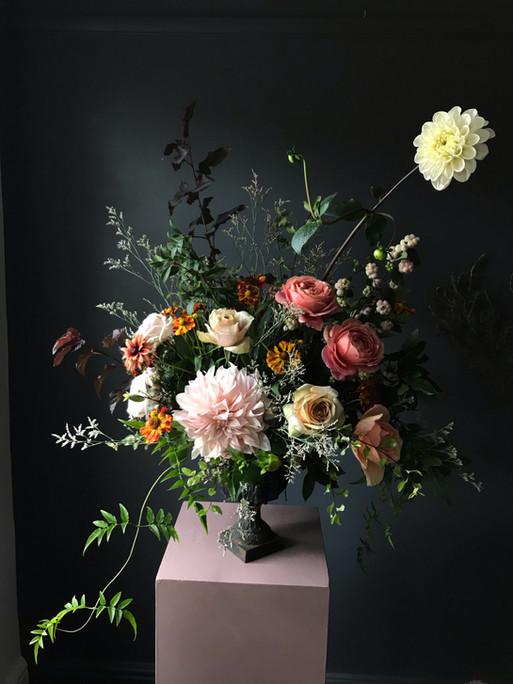 Garden urn for Wedding Reception full of seasonal British flowers