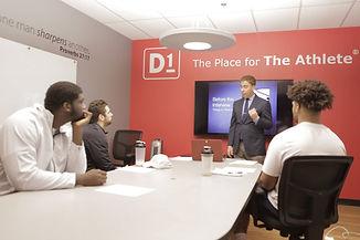 Dan Phillips takes college athletes through media training