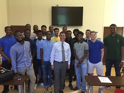 Dan Phillips with the men's basketball team from Columbia State