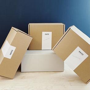 Norlii Box x 3 på blå baggrund.jpg