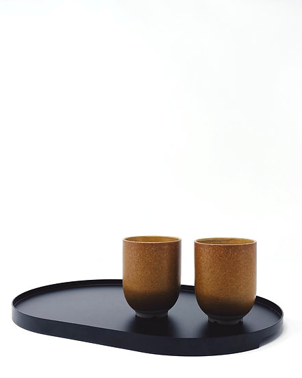 Two Broste cups, caramel brown