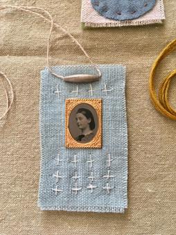 stitched fabric necklace amulet