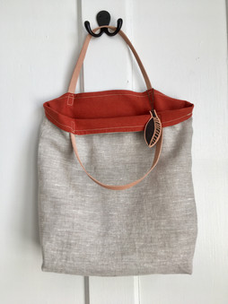 organic linen tote with leather handles and rust fabric lining